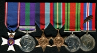 Michael Patrick Ernest Evans : (L to R) Member of the 4th Class of the Royal Victorian Order (MVO); General Service Medal 1918-62 with clasp 'Palestine'; 1939-45 Star; Pacific Star; 1939-45 Defence Medal; 1939-45 War Medal with 'Mentioned in Despatches' oak leaf